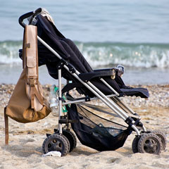 traditional stroller on beach