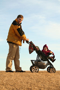 dad pushing baby in a stroller
