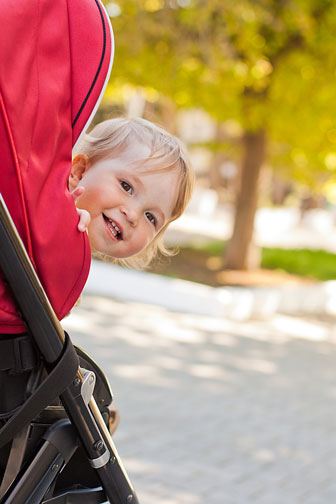 happy baby in a stroller